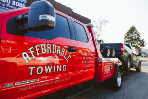 Affordable Towing truck providing emergency roadside assistance.
